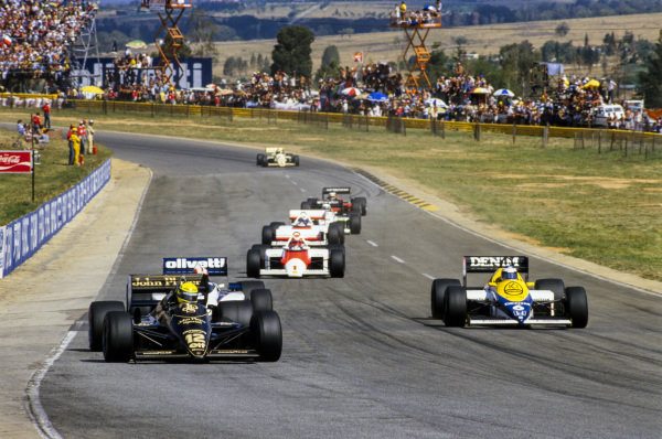 Ayrton Senna, Lotus 97T Renault, leads Marc Surer, Brabham BT54 BMW, Keke Rosberg, Williams FW10 Honda, Niki Lauda, McLaren MP4-2B TAG, and Alain Prost, McLaren MP4-2B TAG.