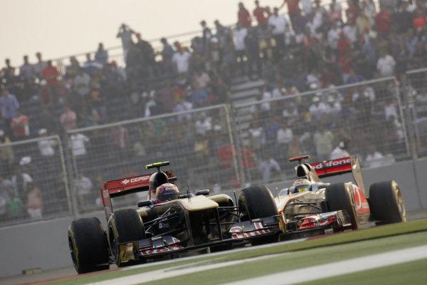 Jaime Alguersuari, Toro Rosso STR6 Ferrari, leads Lewis Hamilton, McLaren MP4-26 Mercedes.