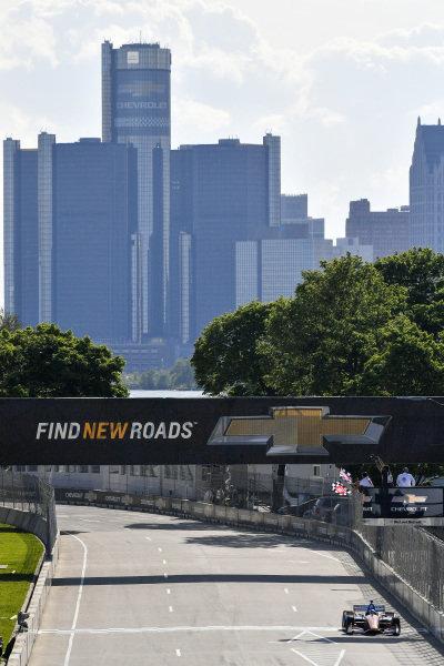 Scott Dixon, Chip Ganassi Racing Honda crosses the finish line under the checkered flag for the win