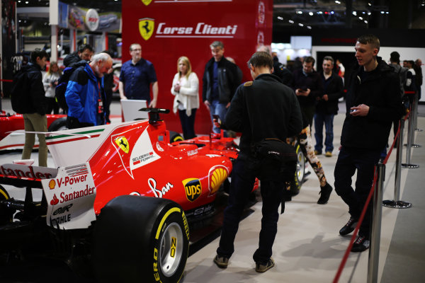 Autosport International Exhibition. National Exhibition Centre, Birmingham, UK. Saturday 13th January 2018. Visitors examine a Ferrari on display.World Copyright: Jakob Ebrey/LAT Images Ref: JR3_3771