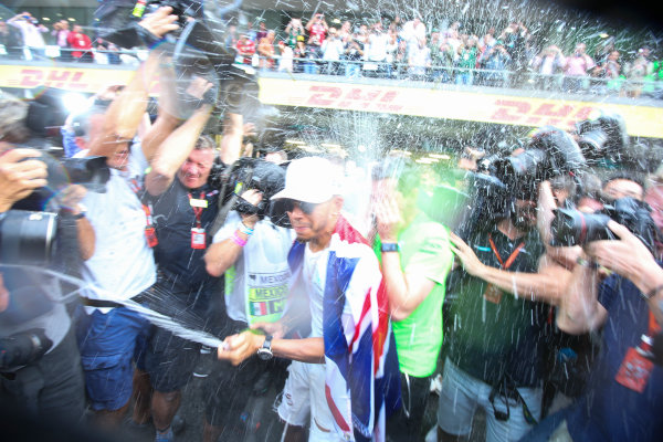 Autodromo Hermanos Rodriguez, Mexico City, Mexico. Sunday 29 October 2017. Lewis Hamilton, Mercedes AMG, sprays Champagne at photographers in celebration of securing his 4th world drivers championship title. World Copyright: Charles Coates/LAT Images  ref: Digital Image DJ5R7720