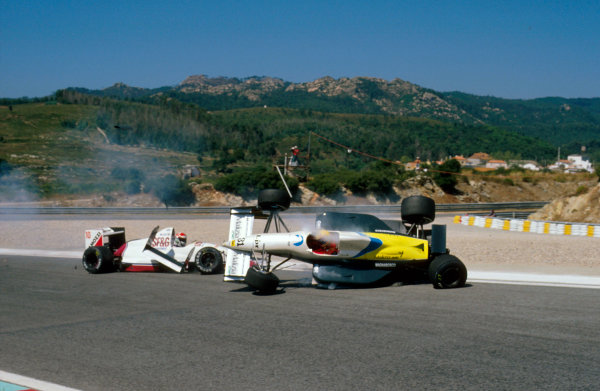 Estoril, Portugal.22-24 September 1989.Roberto Moreno (Coloni FC189 Ford) crashes into Eddie Cheever (Arrows A11 Ford) during qualifying. Ref-89 POR 04.World Copyright - LAT Photographic