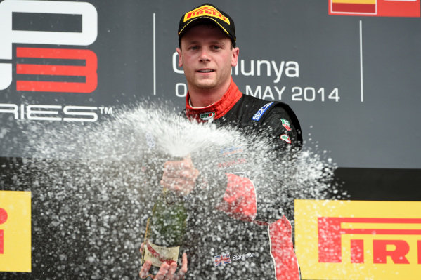 Race two winner Dean Stoneman (GBR) Marussia Manor Racing celebrates on the podium with the champagne. GP3 Series, Rd1, Barcelona, Spain, 9-11 May 2014.