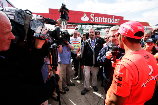 Silverstone, Northamptonshire, UK.6th July 2008.Lewis Hamilton, McLaren MP4-23 Mercedes, 1st position, is interviewed by Steve Rider, ITV F1. Portrait. Media.World Copyright: Charles Coates/LAT Photographic.ref: Digital Image _K5Y2103