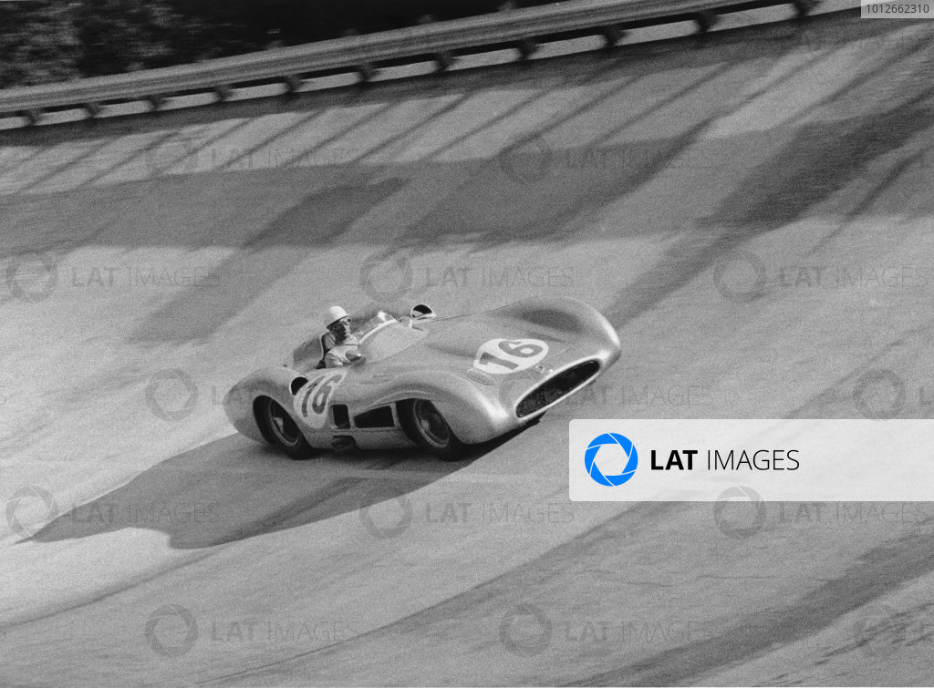 Monza, Italy. 9th - 11th September 1955.Stirling Moss (stream-lined Mercedes-Benz W196), retired, on the banking, action.World Copyright: LAT Photographic.Ref: 337 - 6A.