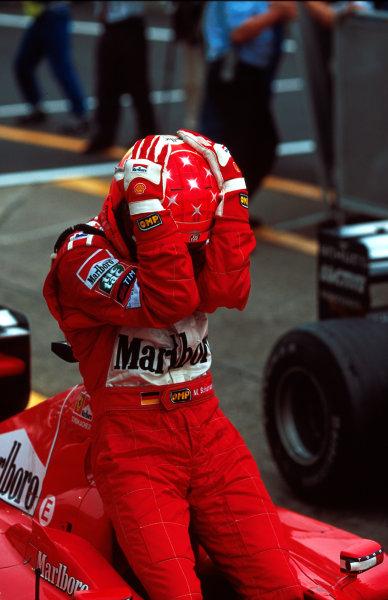 Suzuka, Japan.6-8 October 2000.Michael Schumacher (Ferrari) celebrates after winning the Grand Prix and the drivers World Championship. World copyright - LAT Photographic