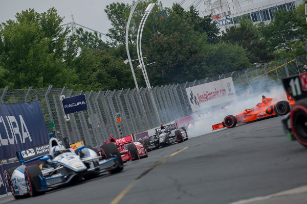 20 July, 2014, Toronto, Ontario, Canada Simon Pagenaud Takuma Sato crash ©2014, Ramesh Bayney LAT Photo USA