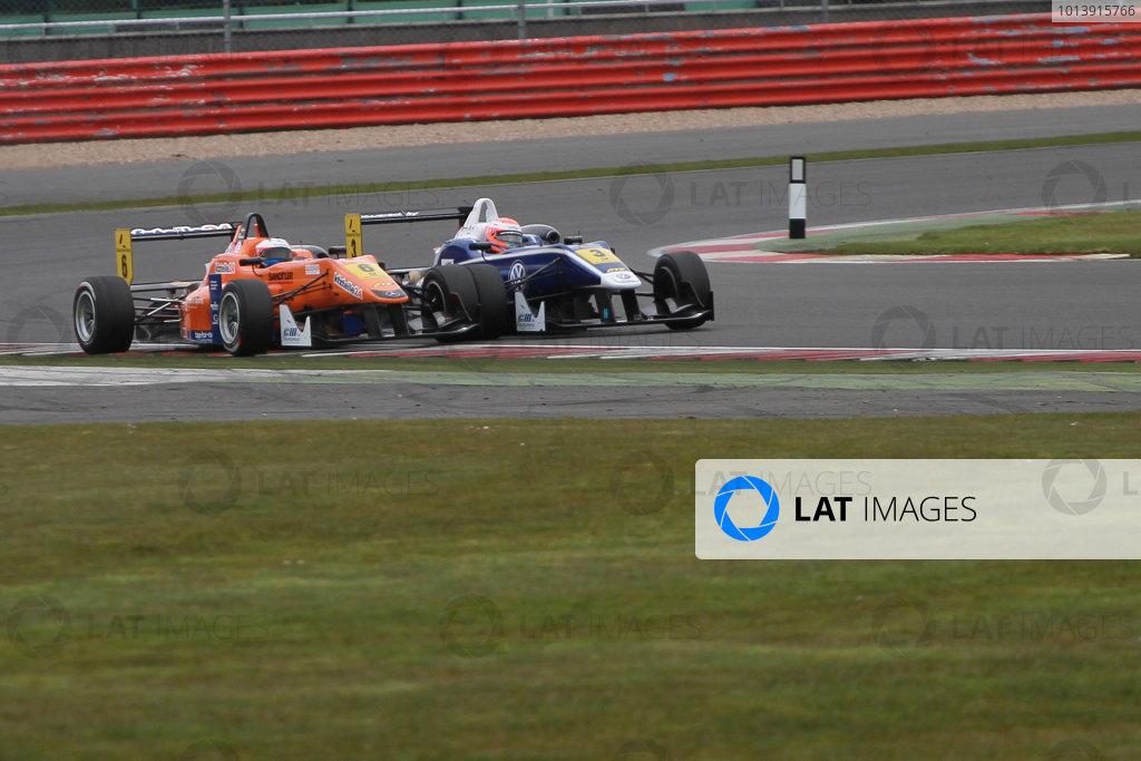 2013 FIA Formula Three Championship, Silverstone, Northamptonshire. 12th - 14th April 2013. Felix Rosenqvist (SWE) Kfzteile24 Mucke Motorsport Dallara Mercedes overtakes Harry Tincknell (GBR) Carlin Dallara Volkswagen World Copyright: Ebrey / LAT Photographic.