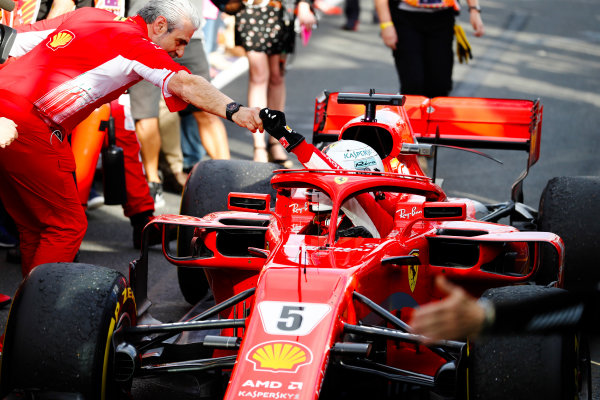 Sebastian Vettel, Ferrari SF71H, is greeted by Maurizio Arrivabene, Team Principal, Ferrari, after taking victory.