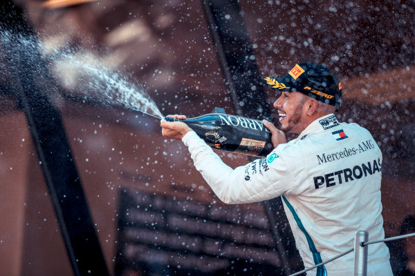 Race winner Lewis Hamilton (GBR) Mercedes-AMG F1 celebrates on the podium with the champagne
