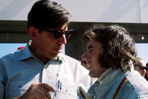 (L to R): Ken Tyrrell (GBR) Tyrrell Team Owner talks with pole sitter Jackie Stewart (GBR) Tyrrell, who finished the race in fifth position.