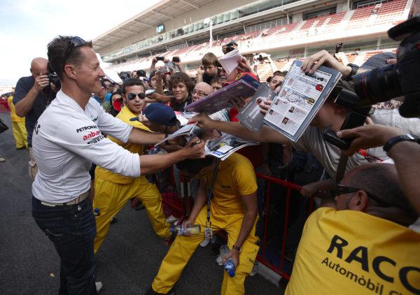 Circuit de Catalunya, Barcelona, Spain 19th May 2011 Michael Schumacher, Mercedes GP W02, signs autographs for fans. Portrait. Atmosphere.  World Copyright: Steve Etherington/LAT Photographic ref: Digital Image SNE23898