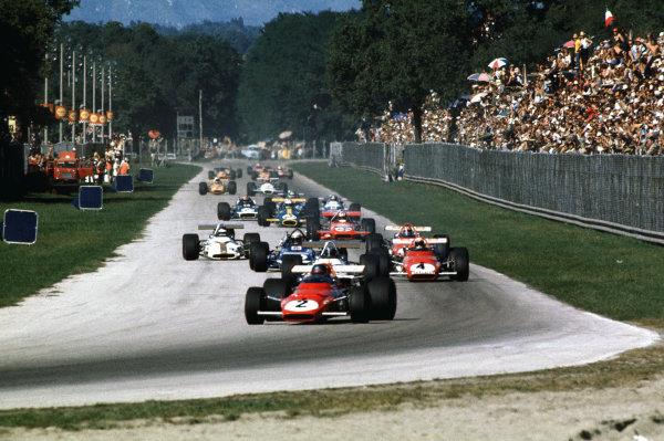 Monza, Italy. 4-6 September 1970.Jacky Ickx (Ferrari 312B), retired, leads Clay Regazzoni (Ferrari 312B), 1st position, on lap 1, action. World Copyright: LAT Photographic.Ref:  70ITA