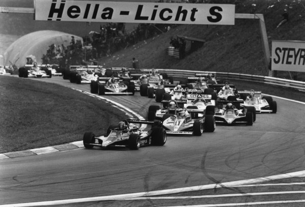Osterreichring, Zeltweg, Austria.11-13 August 1978.Ronnie Peterson (Lotus 79-Ford) leads Carlos Reutemann (Ferrari 312T3) Jacques Laffite (Ligier JS9-Matra) and Mario Andretti (Lotus 79-Ford) at the start.World Copyright: LAT Photographic.Ref:  SL78 - 452 - 8A-9.