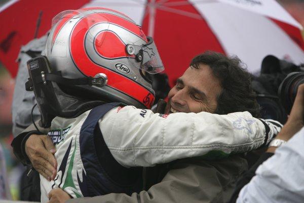2006 GP2 Series Round 9. Hungaroring, Budapest, Hungary. 6th August 2006. Sunday race.Nelson Piquet Jr. (BRA, Piquet Sports) race winner celebrates with his father Nelson Piquet.World Copyright: Andrew Ferraro/GP2 Series Media Service. Ref: Digital Image Only.ZP9O0522 jpg