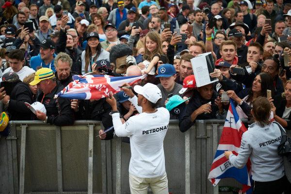 Silverstone, Northamptonshire, UK.  Saturday 15 July 2017. Lewis Hamilton, Mercedes AMG, signs autographs for fans. World Copyright: Steve Etherington/LAT Images  ref: Digital Image SNE12427