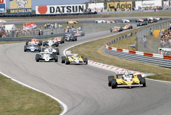 Zandvoort, Holland. 28-30 August 1981.  Alain Prost leads Rene Arnoux (both Renault RE30), Alan Jones (Williams FW07C-Ford Cosworth), Nelson Piquet (Brabham BT49C-Ford Cosworth), Jacques Laffite (Ligier JS17-Matra), Carlos Reutemann (Williams FW07C-Ford Cosworth), Mario Andretti (Alfa Romeo 179C), John Watson (McLaren MP4/1-Ford Cosworth), Elio de Angelis (Lotus 87-Ford Cosworth), Patrick Tambay (Ligier JS17-Matra), Didier Pironi (Ferrari 126CK), Riccardo Patrese (Arrows A3-Ford Cosworth), Bruno Giacomelli (Alfa Romeo 179C), Hector Rebaque (Brabham BT49C-Ford Cosworth), Derek Daly (March 811-Ford Cosworth) and Nigel Mansell (Lotus 87-Ford Cosworth).  Ref: 81HOL17. World Copyright: LAT Photographic