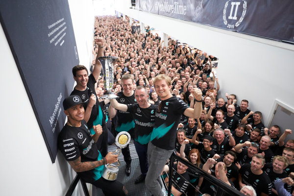 Mercedes AMG Constructors Championship Celebration Brackley, Northants, UK Monday 12th October 2015 Lewis Hamilton, Mercedes AMG, Nico Rosberg, Mercedes AMG, Toto Wolff, Executive Director (Business), Mercedes AMG, Paddy Lowe, Executive Director (Technical), Mercedes AMG and Andy Cowell, Managing Director, HPP, Mercedes AMG line up with the team in the factory. World Copyright: Steve Etherington/LAT Photographic ref: Digital Image SNE22342