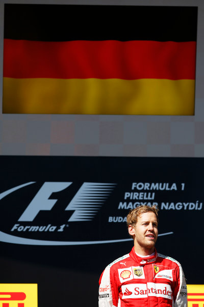 Hungaroring, Budapest, Hungary. Sunday 26 July 2015. Sebastian Vettel, Ferrari, 1st Position, on the podium. World Copyright: Glenn Dunbar/LAT Photographic ref: Digital Image _W2Q1006