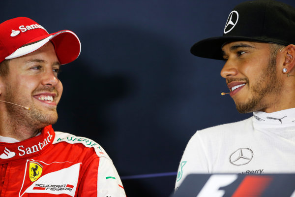 Sochi Autodrom, Sochi, Russia. Sunday 11 October 2015. Sebastian Vettel, Ferrari, 2nd Position, and Lewis Hamilton, Mercedes AMG, 1st Position, in the Press Conference. World Copyright: Alastair Staley/LAT Photographic. ref: Digital Image _R6T2644