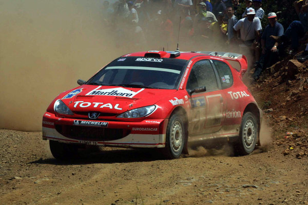 Richard Burns in action in the Peugeot 206 WRC, Acropolis Rally 2003.Photo: McKlein/LAT