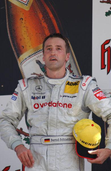 2003 DTM Championship Lausitz, Germany. 6th - 8th June 2003Race winner, Bernd Schneider, podium.World Copyright: Andre Irlmeier/LAT Photographic