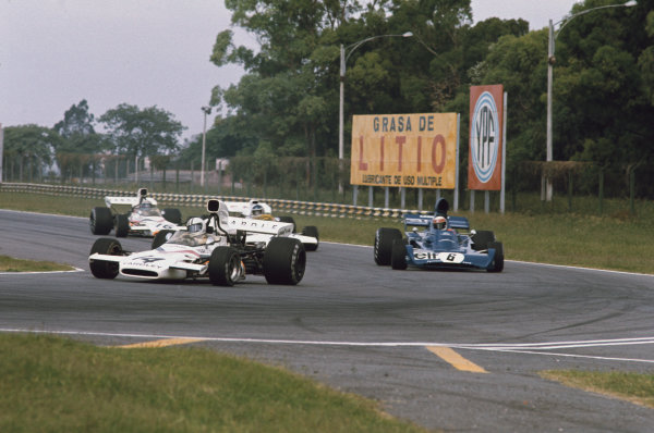 1973 Argentinian Grand Prix.  Buenos Aires, Argentina. 26-28th January 1973.  Denny Hulme, McLaren M19C Ford, leads Jackie Stewart, Tyrrell 005 Ford, Carlos Reutemann, Brabham BT37 Ford, and Peter Revson, McLaren M19C Ford.  Ref: 73ARG36. World Copyright: LAT Photographic