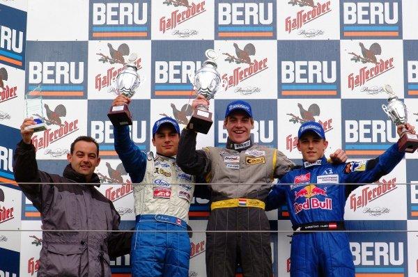 (2nd from left-R) Bruno Spengler (CAN) Jenzer Motorsport 2nd, Ross Zwolsman (NED) ma-con Racing 1st, Christian Klien (AUT) JD Motorsport 3rd.German Formula Renault Championship, Rd6, Races 11 and 12, Nurburgring, Germany. 22 September 2002.DIGITAL IMAGE