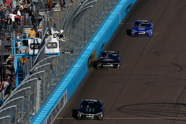 13-14 November, 2015, Avondale, Arizona USA Kyle Busch, Monster Energy Toyota Camry takes the checkered flag and win ?2015, Michael L. Levitt LAT Photo USA