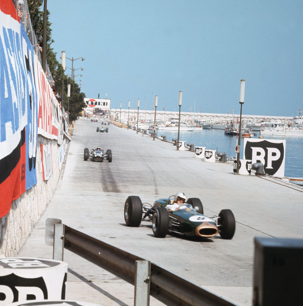 Monte Carlo, Monaco. 19-22 May 1966.Denny Hulme (Brabham BT22 Climax) leads Jochen Rindt (Cooper T81 Maserati).Ref-3/2104.World Copyright - LAT Photographic