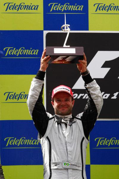Circuit de Catalunya, Barcelona, Spain 10th May 2009 Rubens Barrichello, Brawn GP BGP001 Mercedes, 2nd position, lifts his trophy on the podium. Portrait. Podium. World Copyright: Andrew Ferraro/LAT Photographic ref: Digital Image _H0Y6196