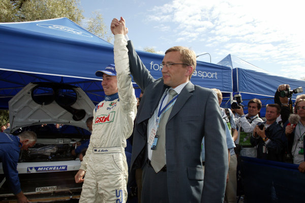 2003 FIA World Rally Champs. Round nine, Neste Rally Finland. Rally7th-10th August 2003.Markko Martin celebrates with Estonian Prime Minister Juhan Parts.World Copyright: McKlein/LAT