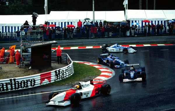 1995 Belgian Grand Prix.Spa-Francorchamps, Belgium.25-27 August 1995.Mark Blundell (McLaren MP4/10B Mercedes) leads Heinz-Harald Frentzen (Sauber C14 Ford), Olivier Panis (Ligier JS41 Mugen Honda) and Mika Salo (Tyrrell 023 Yamaha) at La Source. Blundell and Frentzen finished in 5th and 4th positions respectively.World Copyright - LAT Photographic