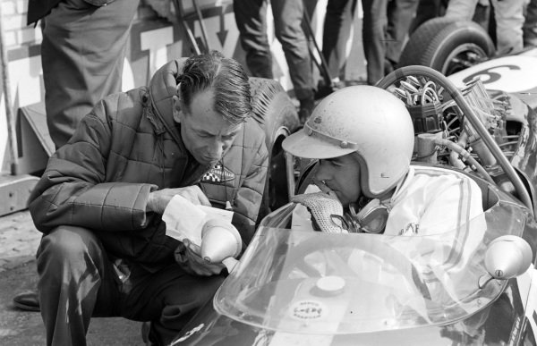 Ron Tauranac speaks with Jack Brabham.