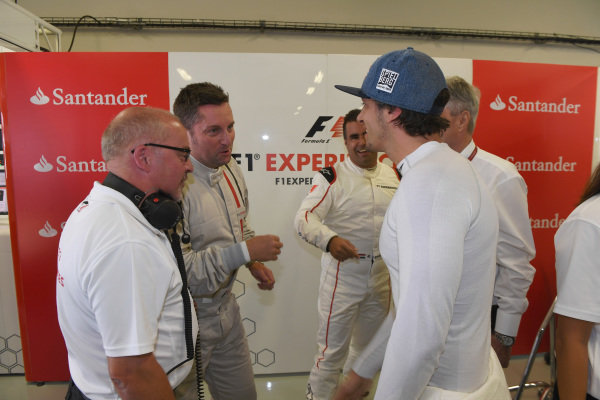 Patrick Friesacher (AUT) F1 Experiences 2-Seater driver and Mike Gascoyne (GBR) and F1 Experiences 2-Seater passengers at Formula One World Championship, Rd18, Mexican Grand Prix, Practice, Circuit Hermanos Rodriguez, Mexico City, Mexico, Friday 27 October 2017.