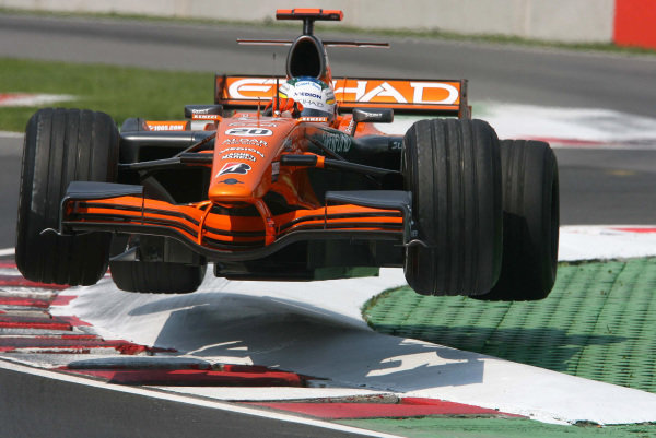 Adrian Sutil, Spyker F8-VII Ferrari, gets airborne over the kerbs at the last chicane during practice.