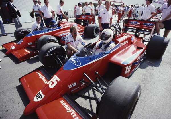 Alan Jones, Haas Lola THL2 Ford, with team-mate Patrick Tambay. Adrian Newey can be seen on the far left of the picture.