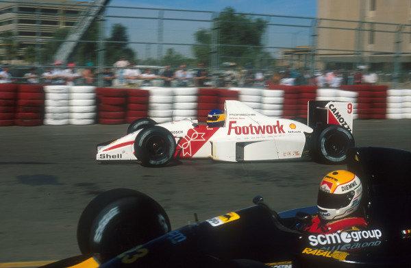 1991 United States Grand Prix.Phoenix, Arizona, U.S A.8-10 March 1991.Michele Alboreto (Footwork A11C Porsche) with Pierluigi Martini (Minardi M191 Ferrari) on the inside.Ref-91 USA 04.World Copyright - LAT Photographic