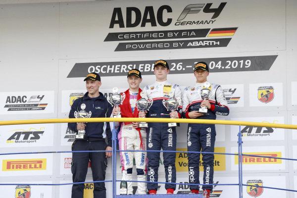 Rookie Winner Roman Stanek, US Racing - CHRS, Second Place, Joshua Dürksen, ADAC Berlin-Brandenburg e.V and Alessandro Ghiretti, US Racing - CHRS on the podium with the trophy