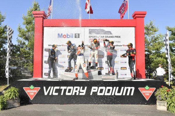 #54 CORE autosport ORECA LMP2, P: Jon Bennett, Colin Braun celebrates the win on the podium with #10 Wayne Taylor Racing Cadillac DPi, P: Renger van der Zande, Jordan Taylor, #31 Action Express Racing Cadillac DPi, P: Eric Curran, Felipe Nasr