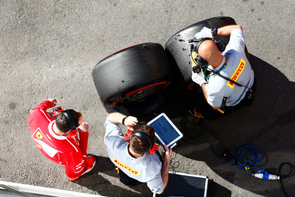 Circuit de Barcelona Catalunya, Barcelona, Spain. Friday 10 March 2017. Ferrari and Pirelli employees work next to some super-soft tyres. World Copyright: Zak Mauger/LAT Images ref: Digital Image _L0U6109