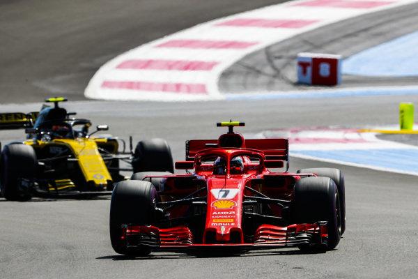 Kimi Raikkonen, Ferrari SF71H, leads Carlos Sainz Jr., Renault Sport F1 Team R.S. 18.