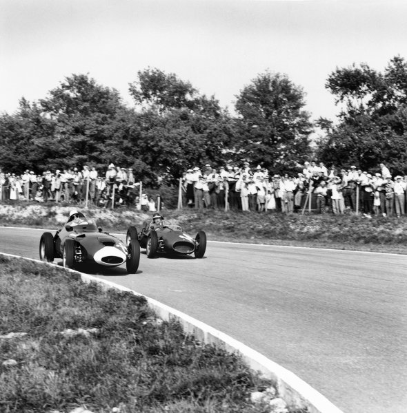 Monza, Italy. 5-7 September 1958.Stirling Moss (Vanwall), retired, leads Mike Hawthorn (Ferrari Dino 246), 2nd position, action.World Copyright: LAT PhotographicRef: 2454.