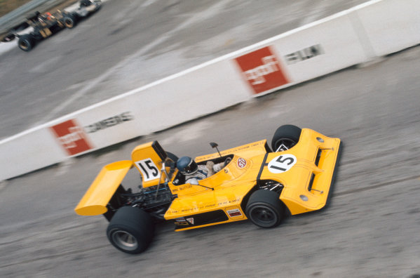 1973 Canadian Grand Prix.  Mosport Park, Ontario, Canada. 21st-23rd September 1973.  Mike Beuttler, March 731 Ford, in the pits while Emerson Fittipaldi, Lotus 72E Ford, goes past on track.  Ref: 73CAN32. World copyright: LAT Photographic