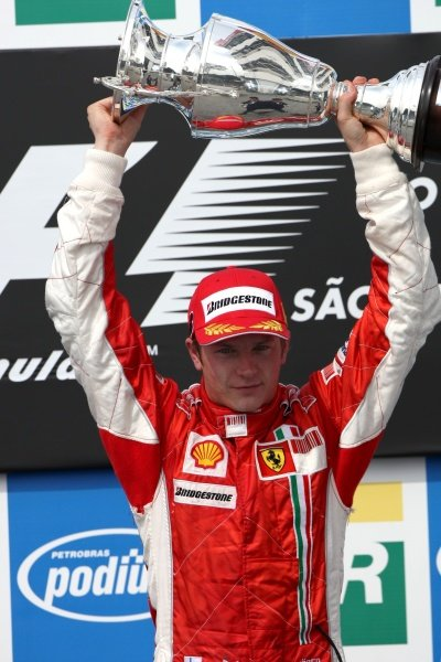 Race winner and Champion Kimi Raikkonen (FIN) Ferrari celebrates on the podium.  Formula One World Championship, Rd17, Brazilian Grand Prix, Race Day, Interlagos, Sao Paulo, Brazil, Sunday 21 October 2007. BEST IMAGE