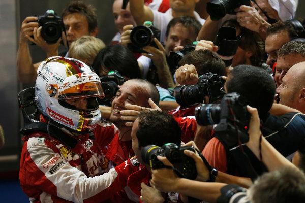 Marina Bay Circuit, Singapore. Sunday 20 September 2015. Sebastian Vettel, Ferrari, 1st Position, celebrates with his team in Parc Ferme. World Copyright: Alastair Staley/LAT Photographic ref: Digital Image _79P3941
