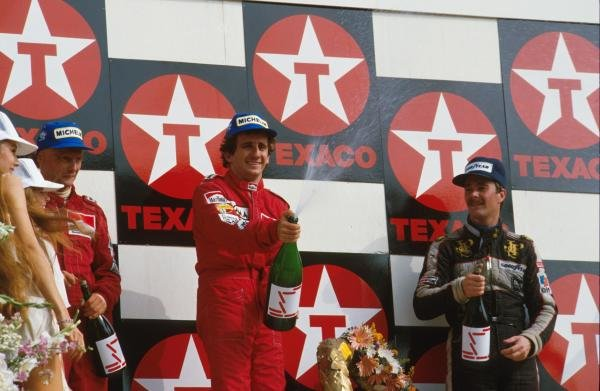 Winner Alain Prost,centre, with second place Niki Lauda, left and third place Nigel Mansell, right. Dutch GP, Zandvoort, 26 August 1984