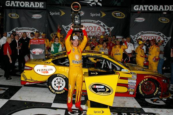 25-26 April, 2014, Richmond, Virginia USA Joey Logano celebrates in victory lane ©2014, Russell LaBounty LAT Photo USA