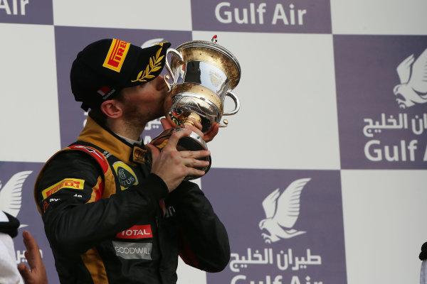 Bahrain International Circuit, Sakhir, Bahrain Sunday 21st April 2013 Romain Grosjean, Lotus F1, 3rd position, kisses his trophy. World Copyright: Andy Hone/LAT Photographic ref: Digital Image HONZ3068