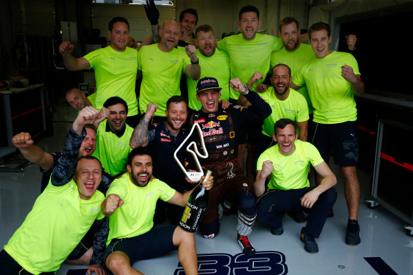 Red Bull Ring, Spielberg, Austria. Sunday 3 July 2016. Max Verstappen, Red Bull Racing, 2nd Position, and Red Bull team mates celebrate with his trophy. World Copyright: Andrew Hone/LAT Photographic ref: Digital Image _ONZ7842